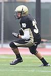 Torrance, CA 10/05/11 - Luke Morrow (Peninsula #33) in action during the Peninsula vs South Torrance Junior Varsity football game.
