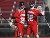 JP Lannig #22 of Syosset, right, gets congratulated by teammate #20 Liam Kalbacher after he scored a goal to extend the lead over Garden City to 3-1 in the first quarter of a non-league varsity boys lacrosse game at Garden City High School on Tuesday, Mar. 22, 2016. Syosset won by a score of 6-3.