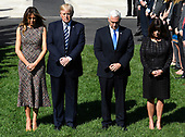 United States President Donald J. Trump (2nd,L), first lady Melania Trump (L), US Vice President Mike Pence (2nd,R) and his wife Karen join White House staff for a moment of silence on the South Lawn of the White House, Washington, DC, for the mass shooting in Las Vegas, Nevada, October 2, 2017.                 <br /> Credit: Mike Theiler / CNP