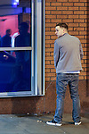 © Joel Goodman - 07973 332324 . No syndication permitted . 01/01/2014 . Manchester , UK . A man urinates against a wall on Withy Grove in Central Manchester . Revellers see in the New Year in Manchester today (January 1st 2014) as police report that officers are at full stretch responding to calls . Photo credit : Joel Goodman