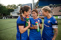 Seattle, WA - Saturday, July 02, 2016: Seattle Reign FC defender Kendall Fletcher (13), Seattle Reign FC forward Nahomi Kawasumi (36) and Seattle Reign FC midfielder Jessica Fishlock (10) after a regular season National Women's Soccer League (NWSL) match between the Seattle Reign FC and the Boston Breakers at Memorial Stadium. Seattle won 2-0.