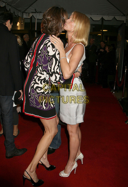 """BRENDA STRONG & NICOLLETTE SHERIDAN.""""Over Her Dead Body"""" Los Angeles Premiere held at the ArcLight Cinemas Cinerama Dome Theater, Santa Monica, California, USA..January 29th 2008.full length silver white mini dress bow grey gray shoes Nicolette hug embrace black red print pattern purple .CAP/ADM/RE.©Russ Elliot/AdMedia/Capital Pictures."""