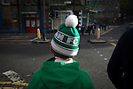A young home supporter in a bobble hat making his way from Easter Road stadium at the conclusion of the Scottish Championship match between Hibernian and visitors Alloa Athletic. The home team won the game by 3-0, watched by a crowd of 7,774. It was the Edinburgh club's second season in the second tier of Scottish football following their relegation from the Premiership in 2013-14.