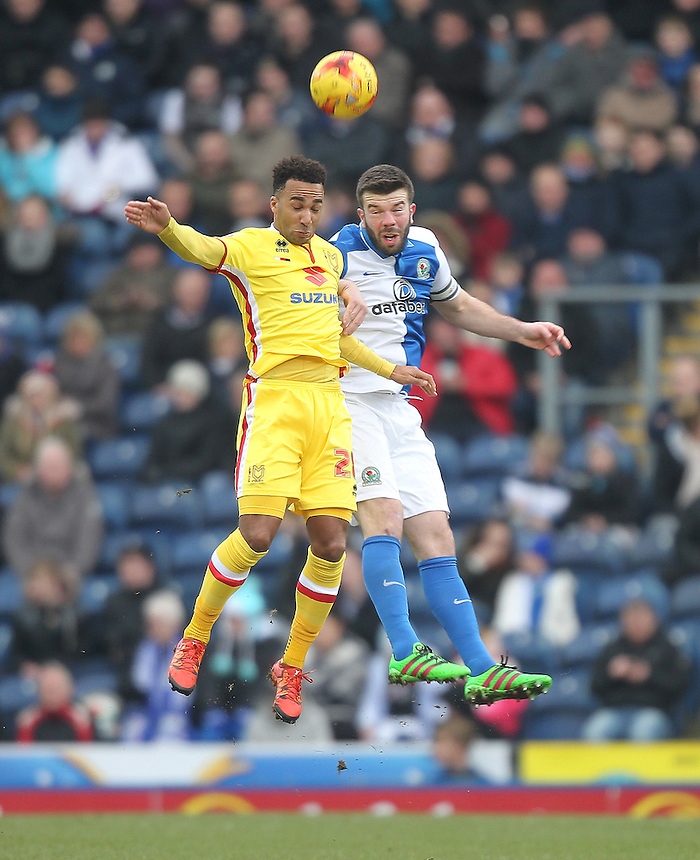 Blackburn Rovers Grant Hanley jumps with Milton Keynes Dons Charlie Burns<br /> <br /> Photographer Mick Walker/CameraSport<br /> <br /> Football - The Football League Sky Bet Championship - Blackburn Rovers v Milton Keynes Dons - Saturday 27th February 2016 - Ewood Park - Blackburn<br /> <br /> &copy; CameraSport - 43 Linden Ave. Countesthorpe. Leicester. England. LE8 5PG - Tel: +44 (0) 116 277 4147 - admin@camerasport.com - www.camerasport.com