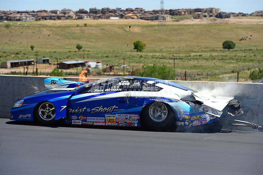 Jul, 22, 2012; Morrison, CO, USA: NHRA pro stock driver Paul Pittman crashes during the Mile High Nationals at Bandimere Speedway. Pittman would be uninjured in the incident. Mandatory Credit: Mark J. Rebilas-