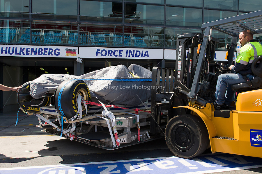 MELBOURNE, 11 March - A Sahara Force India F1 Team car is unloaded from the transporter ahead of the 2012 Formula One Australian Grand Prix at the Albert Park Circuit in Melbourne, Australia. (Photo Sydney Low / syd-low.com)