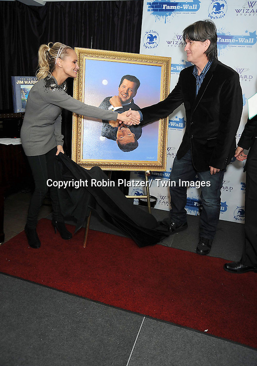 Kristin Chenoweth and Jim Warren at the unveiling of portraits of Sean Hayes and Kristin Chenoweth by Jim Warren, the artist, at Trattoria Dopo.Teatro in New York City on November 21, 2010.