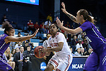 21 March 2015: Ohio State's Asia Doss (center) is defended by James Madison's Jazmon Gwathmey (right) and Toia Giggetts (left). The Ohio State University Buckeyes played the James Madison University Dukes at Carmichael Arena in Chapel Hill, North Carolina in a 2014-15 NCAA Division I Women's Basketball Tournament first round game.