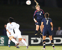 Rachel Buehler (4) of USA leaps high for a header during an international friendly match against South Korea at City Stadium on November 1, 2008 in Richmond, Virginia. USA won 3-1.