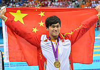 August 04, 2012..Yang Sun pose for a photograph with Men's 1500m Freestyle Gold Medal at the Aquatics Center on day eight of 2012 Olympic Games in London, United Kingdom.