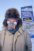 Resident of Fairbanks, Alaska, wears glasses with frozen icicles to convey the deep winter cold temperature of 44 below zero in Fairbanks, Alaska.