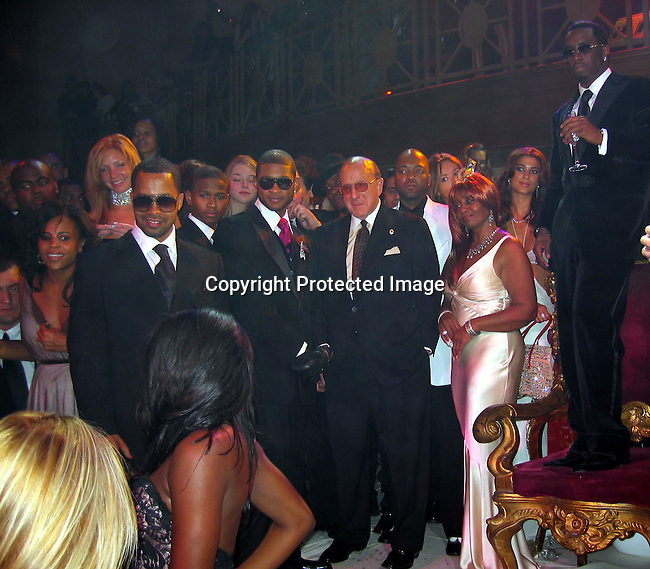 Usher, Clive Davis, Janice Combs, Sean P. Diddy Combs looking at the girls dancing that just came out of a cake<br />