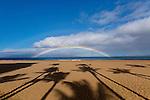 A rainbow over the sand beach and Pacific Ocean at Kaanapali Point, Lahaina, Maui, Hawaii