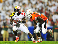 Terrapin's Kenny Tate tries to elude a Hurricane defender. Maryland defeated Miami 32-24 during a game at the Byrd Stadium in College Park, MD on Monday, September 5, 2011. Alan P. Santos/DC Sports Box