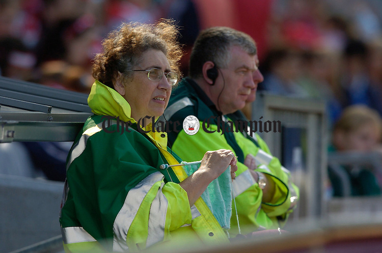 Dr. Moira Woolfson continues with her knitting  as she attends the All-Ireland Camogie finals in Croke Park. Photograph by John Kelly