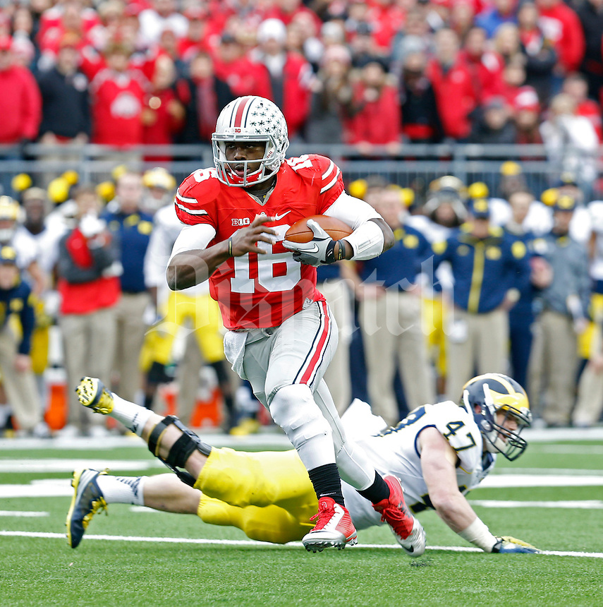 Ohio State Buckeyes quarterback J.T. Barrett (16) gets past Michigan Wolverines linebacker Jake Ryan (47) to score a touchdown on a run in the 2nd quarter of their game at Ohio Stadium in Columbus, Ohio on November 29, 2014.  (Dispatch photo by Kyle Robertson)