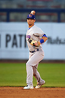 Midland RockHounds shortstop Chad Pinder (2) throws to first after fielding a ground ball during a game against the Tulsa Drillers on June 2, 2015 at Oneok Field in Tulsa, Oklahoma.  Midland defeated Tulsa 6-5.  (Mike Janes/Four Seam Images)