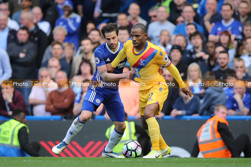 Jason Puncheon of Crystal Palace and Cesc Fabregas of Chelsea during Chelsea vs Crystal Palace, Premier League Football at Stamford Bridge on 1st April 2017