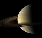 The Cassini spacecraft captured this natural color view of Saturn almost a month after the planet's August 2009 equinox. The shadow cast on the planet by the rings remains narrow. Spokes are visible on the B ring. To learn more about these ghostly radial structures, see 'Tis the Season for Spokes. Mimas (396 kilometers, or 246 miles across) can be seen in the lower left. Mimas and the rings have been brightened relative to the planet to increase visibility. The novel illumination geometry that accompanies equinox lowers the sun's angle to the ringplane, significantly darkens the rings, and causes out-of-plane structures to look anomalously bright and cast shadows across the rings. These scenes are possible only during the few months before and after Saturn's equinox, which occurs only once in about 15 Earth years. Before and after equinox, Cassini's cameras have spotted not only the predictable shadows of some of Saturn's moons, but also the shadows of newly revealed vertical structures in the rings themselves.  This view looks toward the northern, sunlit side of the rings from about 10 degrees above the ringplane.  The red, green and blue images that were mosaicked together to create this view were obtained with the Cassini spacecraft wide-angle camera on Sept. 4, 2009. The view was obtained at a distance of approximately 2.7 million kilometers (1.7 million miles) from Saturn and at a Sun-Saturn-spacecraft, or phase, angle of 92 degrees. Image scale is 156 kilometers (97 miles) per pixel..Credit: NASA-JPL-Space Science Institute via CNP