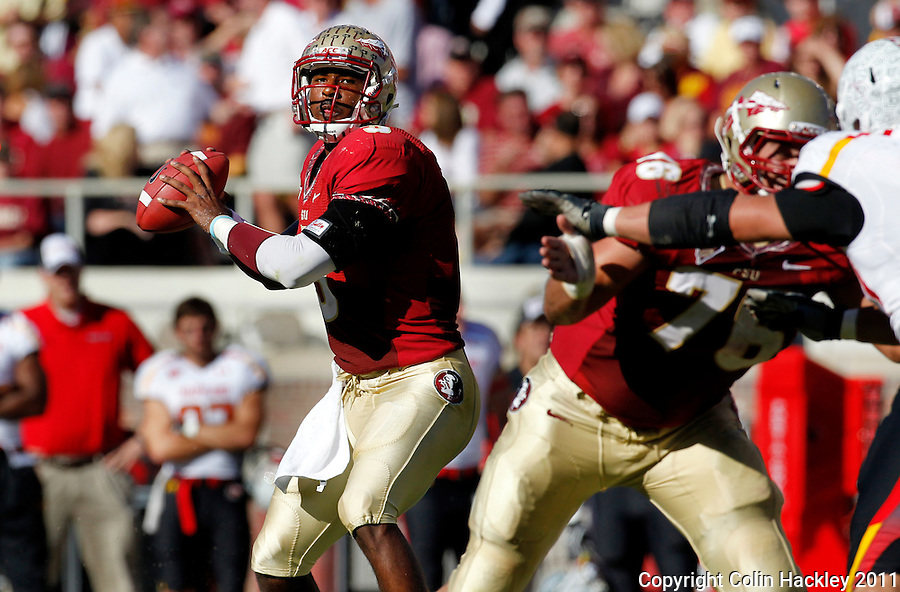 TALLAHASSEE, FL 10/22/11-FSU-MARY102211 CH-Florida State quarterback EJ Manuel looks for a receiver during first half action against Maryland Saturday at Doak Campbell Stadium in Tallahassee. .COLIN HACKLEY PHOTO