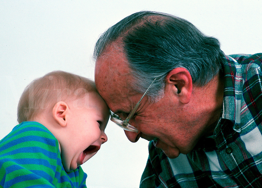 Grandfather and infant laughing