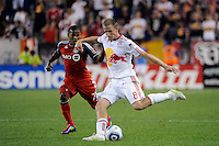 Jan Gunnar Solli (8) of the New York Red Bulls plays the ball under pressure from Joao Plata (7) of Toronto FC. The New York Red Bulls defeated Toronto FC 5-0 during a Major League Soccer (MLS) match at Red Bull Arena in Harrison, NJ, on July 06, 2011.