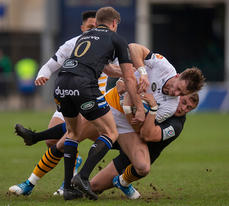 Wasps' Josh Bassett is tackled by Bath Rugby's Jack Walker<br /> <br /> Photographer Bob Bradford/CameraSport<br /> <br /> European Rugby Heineken Champions Cup Pool 1 - Bath Rugby v Wasps - Saturday 12th January 2019 - The Recreation Ground - Bath<br /> <br /> World Copyright © 2019 CameraSport. All rights reserved. 43 Linden Ave. Countesthorpe. Leicester. England. LE8 5PG - Tel: +44 (0) 116 277 4147 - admin@camerasport.com - www.camerasport.com