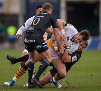 Wasps' Josh Bassett is tackled by Bath Rugby's Jack Walker<br /> <br /> Photographer Bob Bradford/CameraSport<br /> <br /> European Rugby Heineken Champions Cup Pool 1 - Bath Rugby v Wasps - Saturday 12th January 2019 - The Recreation Ground - Bath<br /> <br /> World Copyright &copy; 2019 CameraSport. All rights reserved. 43 Linden Ave. Countesthorpe. Leicester. England. LE8 5PG - Tel: +44 (0) 116 277 4147 - admin@camerasport.com - www.camerasport.com