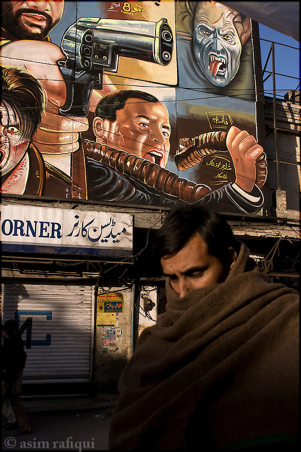 peshawar street scene, in front of a local cinema house