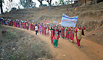 "Women march together in celebration of International Women's Day on March 8, 2016, in Dhawa, a village in the Gorkha District of Nepal. <br /> <br /> The banner reads, ""106th International Women's Day"" and ""Implement the Constitution and Guarantee Women's Rights."""