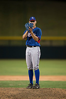 AZL Rangers relief pitcher Chris Morris (16) looks in for the sign during an Arizona League game against the AZL Cubs 2 at Sloan Park on July 7, 2018 in Mesa, Arizona. AZL Rangers defeated AZL Cubs 2 11-2. (Zachary Lucy/Four Seam Images)