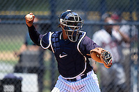 GCL Yankees 1 catcher Roybell Herrera (60) throws down to second in between innings during the first game of a doubleheader against the GCL Braves on July 1, 2014 at the Yankees Minor League Complex in Tampa, Florida.  GCL Yankees 1 defeated the GCL Braves 7-1.  (Mike Janes/Four Seam Images)