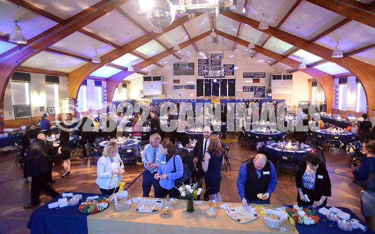 Guests mingle in the school gymnasium during Our Lady of Mt. Carmel School's 140th Anniversary celebration Saturday, April 9, 2016 at the school in Doylestown, Pennsylvania.  (Photo by William Thomas Cain)