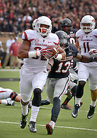 STAFF PHOTO BEN GOFF  @NWABenGoff -- 09/13/14 Arkansas running back Jonathan Williams outruns Texas Tech defender Sam Eguavoen as he runs into the end zone for his second touchdown in the first quarter of the game in Jones AT&T Stadium in Lubbock, Texas on Saturday September 13, 2014.