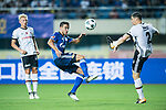 FC Schalke Forward Franco Di Santo (L) trips up with Besiktas Istambul Defender Matej Mitrovic (R) during the Friendly Football Matches Summer 2017 between FC Schalke 04 Vs Besiktas Istanbul at Zhuhai Sport Center Stadium on July 19, 2017 in Zhuhai, China. Photo by Marcio Rodrigo Machado / Power Sport Images