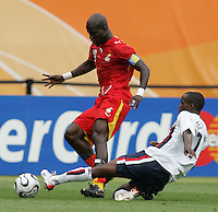 U.S. midfielder (17) DaMarcus Beasley tackles the ball away from Ghananian midfielder (10) Stephen Appiah. Ghana defeated the USA 2-1 in their FIFA World Cup Group E match at Franken-Stadion, Nuremberg, Germany, June 22, 2006. Ghana advances to round of 16 and the USA is out of the tournament.