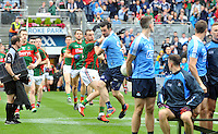 Dublin's Michael Darragh Macauley and Mayo's Keith Higgins tussle even before a ball is kicked as the teams enter Croke Park for their team photograph before the All-Ireland final on Sunday.<br /> Photo: Don MacMonagle