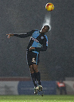 Anthony Stewart of Wycombe Wanderers heads the ball in the rain during the Sky Bet League 2 match between Wycombe Wanderers and Morecambe at Adams Park, High Wycombe, England on 2 January 2016. Photo by Andy Rowland / PRiME Media Images