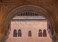 Horseshoe arch in carved stucco in the portico of the Patio of the Gilded Room, between the Mexuar and the Gilded Room or Cuarto Dorado in the Comares Palace, with intricately carved wall with latticed windows beyond, Alhambra Palace, Granada, Andalusia, Southern Spain. It was built under Mohammed V in the 14th century. The Alhambra was begun in the 11th century as a castle, and in the 13th and 14th centuries served as the royal palace of the Nasrid sultans. The huge complex contains the Alcazaba, Nasrid palaces, gardens and Generalife. Picture by Manuel Cohen