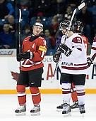 Tristan Scherwey (Switzerland - 10), Ronalds Kenins (Latvia - 15) - Team Switzerland defeated Team Latvia 7-5 on Wednesday, December 30, 2009, at the Credit Union Centre in Saskatoon, Saskatchewan, during the 2010 World Juniors tournament.
