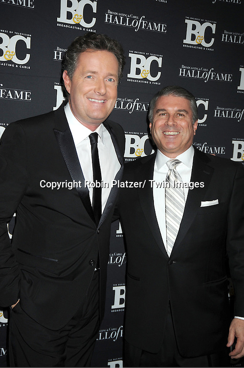 Piers Morgan and honoree Ted Harbert attends the 2011 Broadcasting & Cable Hall of Fame Awards on October 26, 2011 at the Waldorf Astoria Hotel in New York City.