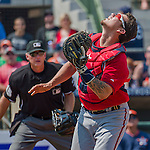 20 March 2015: Washington Nationals catcher Jose Lobaton tracks down a pop foul during a Spring Training game against the Houston Astros at Osceola County Stadium in Kissimmee, Florida. The Nationals defeated the Astros 7-5 in Grapefruit League play. Mandatory Credit: Ed Wolfstein Photo *** RAW (NEF) Image File Available ***