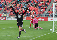 06 October 2012: D.C. United forward Hamdi Salihi #9 celebrates the only goal during an MLS game between DC United and Toronto FC at BMO Field in Toronto, Ontario Canada. .D.C. United won 1-0..