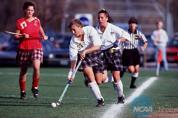Caption:  Trenton State's Jennifer Maholland (#33) moves the ball down the field at the Division III Field Hockey Championship November 12, 1994, in Grantham, Pennsylvania. Courtland State won the championship 2-1. Phil Masturzo/NCAA Photos.