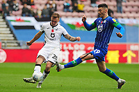 Ben Wilmot of Swansea City battles with Kieffer Moore of Wigan Athletic during the Sky Bet Championship match between Wigan Athletic and Swansea City at The DW Stadium in Wigan, England, UK. Saturday 2 November 2019
