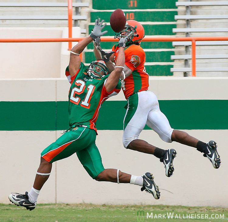 FAMU wide receiver Derek Williams, right, managed to come down with this touchdown pass dispite the efforts of defensive back Michael Creary (21) during the Orange and Green spring football game at Bragg Memorial Stadium Saturday April 14, 2007.  (Mark Wallheiser/TallahasseeStock.com)