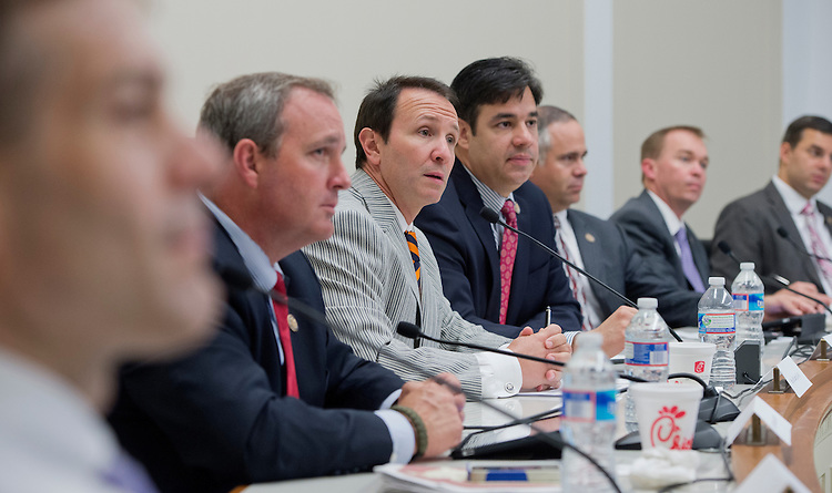 UNITED STATES - MAY 09:  From left, Reps. Jim Jordan, R-Ohio, Jeff Duncan, R-S.C., Jeff Landry, R-La., Raul Labrador, R-Idaho, Tim Huelskamp, R-Kan., Mick Mulvaney, R-S.C., and Justin Amash, R-Mich., conduct a forum in Rayburn called a Conversations with Conservatives to discuss issues including appropriations and the upcoming reconciliation package. (Photo By Tom Williams/CQ Roll Call)