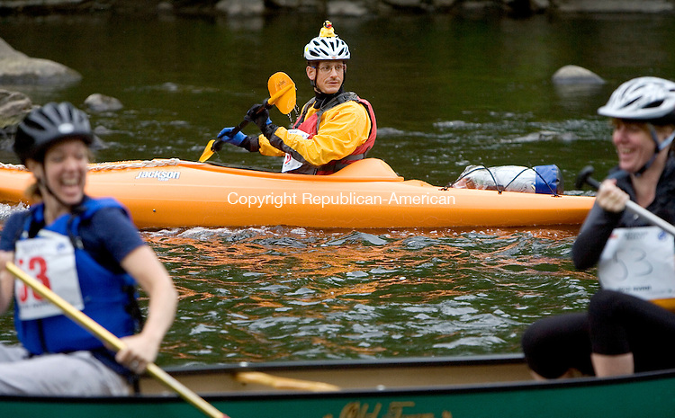 WATERBURY, CT. 05 May 2012-050512SV07-John Dyckman of Prospect wears his duck proudly on his helmet during the fifth annual Naugatuck Valley River Race on the Naugatuck River in Waterbury Saturday. Two popular Naugatuck Valley events, the fifth annual River Race and the 14th annual Riverfest Duck Race, combined this year. The paddling ended six miles south before the Depot Street Bridge in Beacon Falls where the duck race took place..Steven Valenti Republican-American