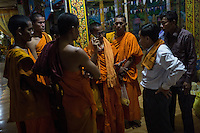 December 03, 2013 - Kampong Thom, Cambodia. Monks and activists in a pagoda during a 10 day Human Rights march through the country. © Nicolas Axelrod / Ruom