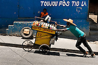 A Haitian man sells home made refreshing drinks on the street market in Port-au-Prince, Haiti, 13 July 2008.